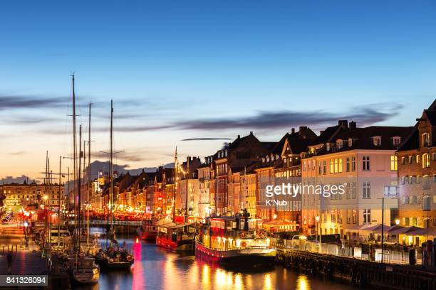 A view of famous colorful building, boat, ship and water front canal, Nyhavn in Denmark Europe