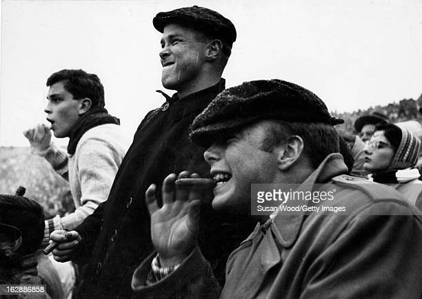 View of fans in the grandstand during a college football game the Yale Bowl between Harvard and Yale New Haven Connecticut November 1955