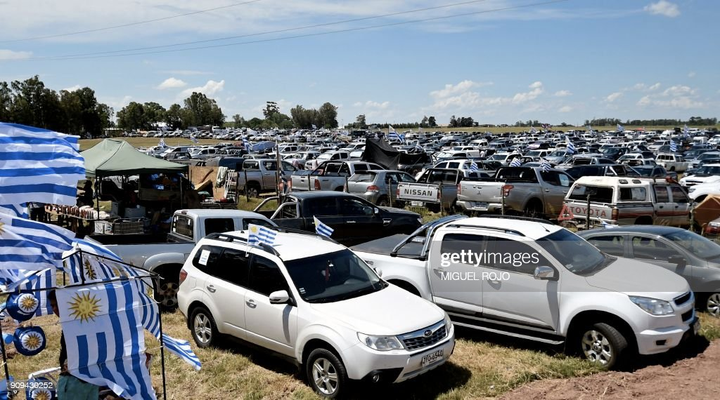 View of farmers, traders and haulage contractors parked cars that ...