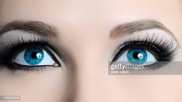 view of female blue eyes with long lashes - false eyelash stock pictures, royalty-free photos & images