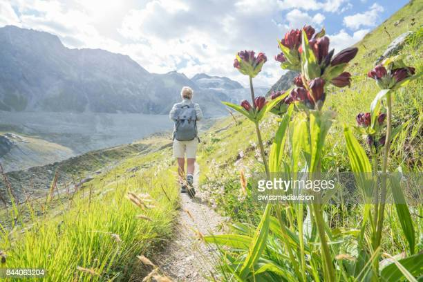 View of female hiking on sunny day, Switzerland