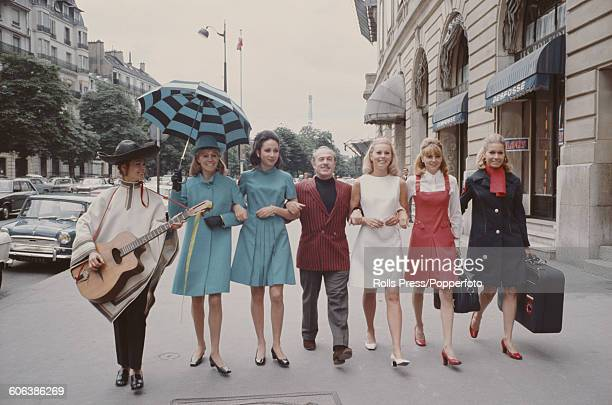 View of female models wearing the new uniforms of the French Olympic team for the 1968 Summer Olympics in Mexico City Mexico walking along a street...