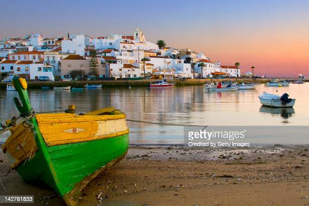 view of ferragudo at dusk, portugal - algarve stock photos and pictures
