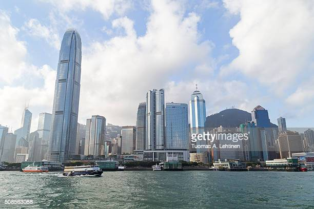 view of ferries and skyscrapers in central and sheung wan at the hong kong island in hong kong, china, from the ocean. - 上環 ストックフォトと画像