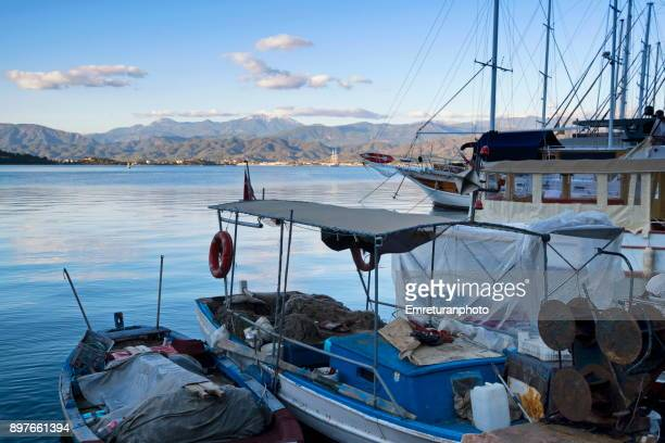 view of fethiye bay from harbor promenade at sunset. - emreturanphoto stock pictures, royalty-free photos & images
