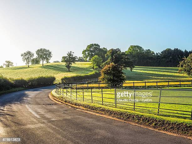 view of field against clear sky - warwick uk stock photos and pictures