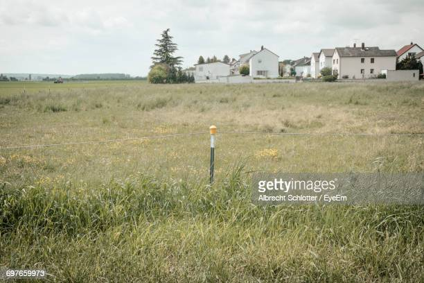 view of field against cloudy sky - albrecht schlotter stock pictures, royalty-free photos & images