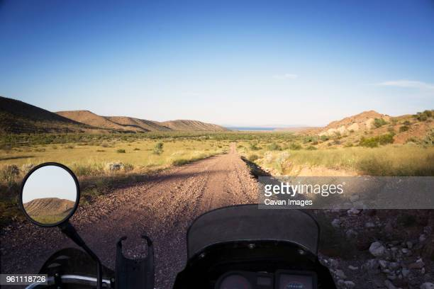 view of field from motorcycle - vehicle mirror stock photos and pictures
