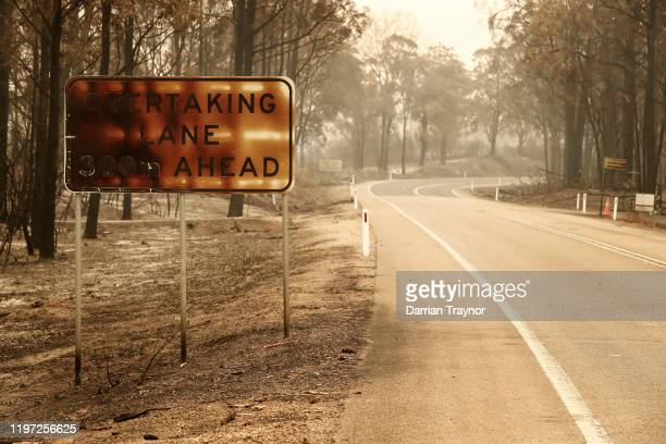A view of fire damage on January 03 2020 in Sarsfield Australia The HMAS Choules docked outside of Mallacoota this morning to evacuate thousands of...