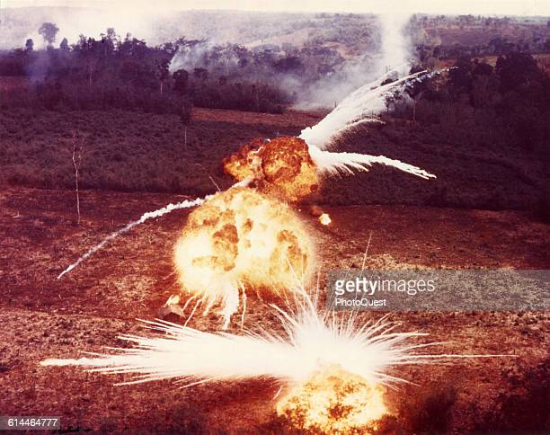 View of fireballs from ignited napalm dropped on suspected Viet Cong targets South Vietnam 1966