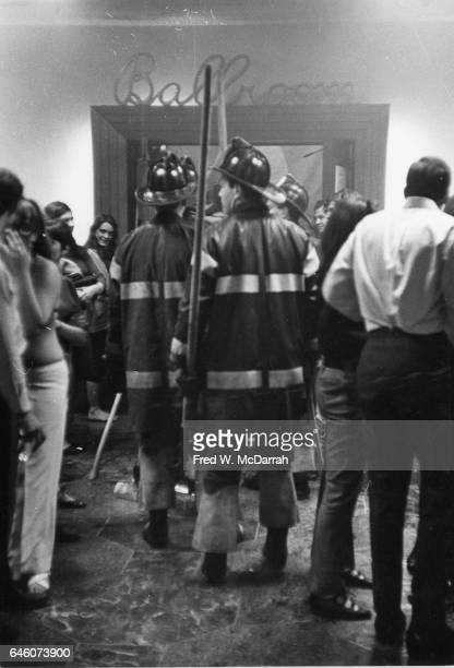 View of firefighters and onlookers stand in a hallway near the entrance to the 'Ballroom' after a massive structural collapse in the University Hotel...