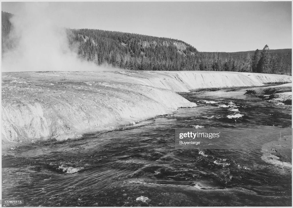 View of Firehole River in foreground, with trees behind, at Yellowstone National Park, Wyoming, 1942.