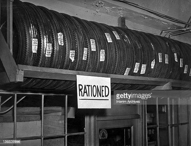 View of Firestone tires stacked for rationing in an effort to save on rubber goods during World War II mid twentieth century