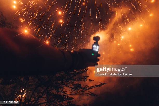view of fireworks against sky at night - recording video and taking photos with action camera - koukichi stock pictures, royalty-free photos & images