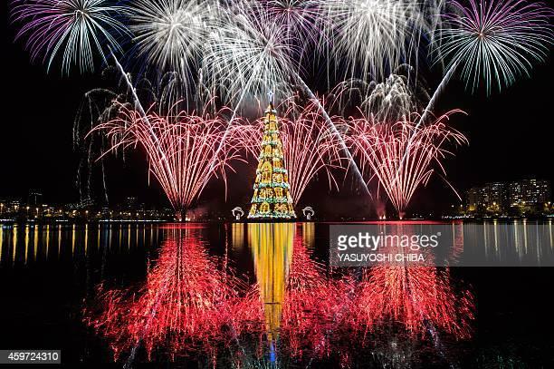 View of fireworks during the inauguration of an 85meterhigh floating Christmas tree at Rodrigo de Freitas lagoon in Rio de Janeiro Brazil on November...