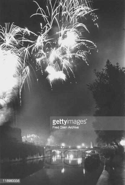 View of fireworks over the Seine river near the Pont de l'Archeveche in celebration of Bastille Day Paris France July 14 1935
