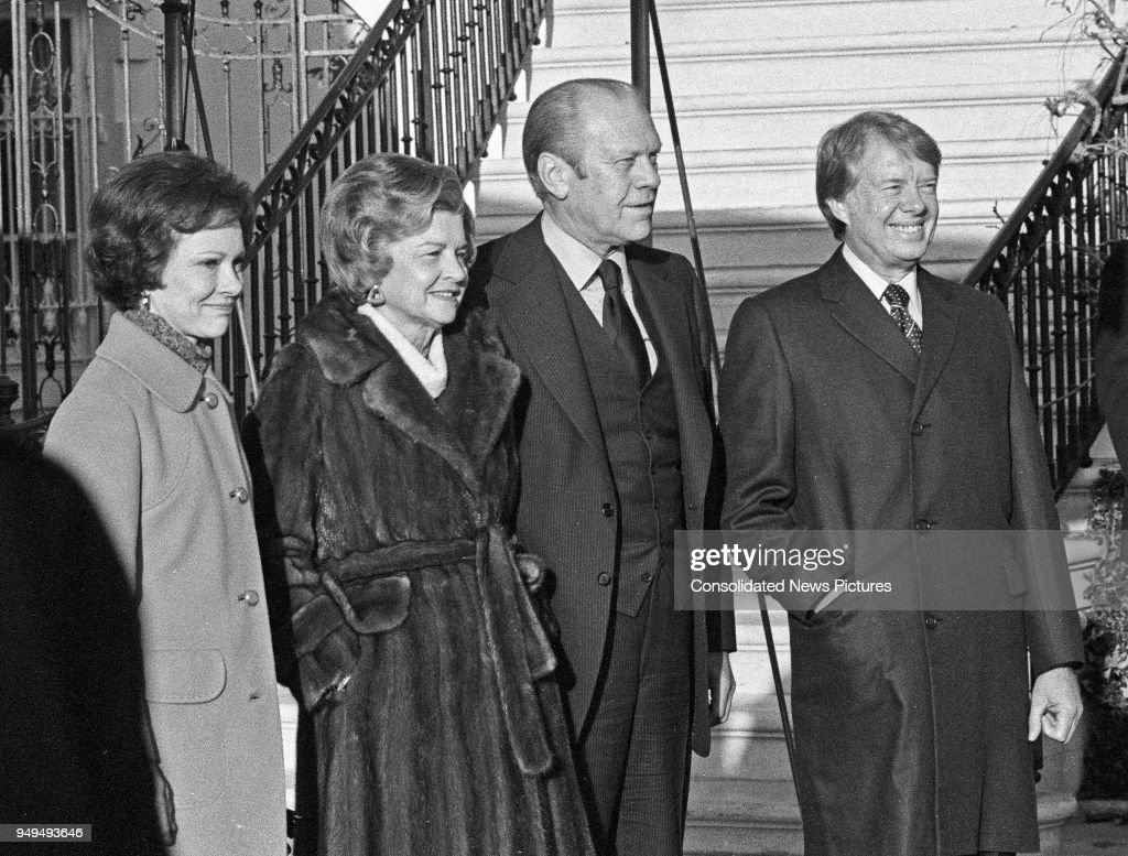 View of First Lady Betty Ford (1918 - 2011) (center left) and US President Gerald Ford (1913 - 2006) (center right) welcome incoming First Lady Rosalynn Carter and US President-Elect Jimmy Carter to the White House, Washington DC, November 22, 1976. The event marked the first time the two men had met since Carter defeated the incumbant Ford in the Presidential election.