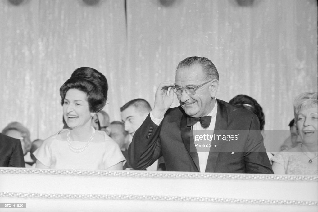 View of First Lady Lady Bird Johnson (born Claudia Alta Taylor, 1912 - 2007) and US President Lyndon B Johnson (1908 - 1973) laugh during an Inaugural Ball at the Sheraton Park Hotel, Washington DC, January 20, 1965.