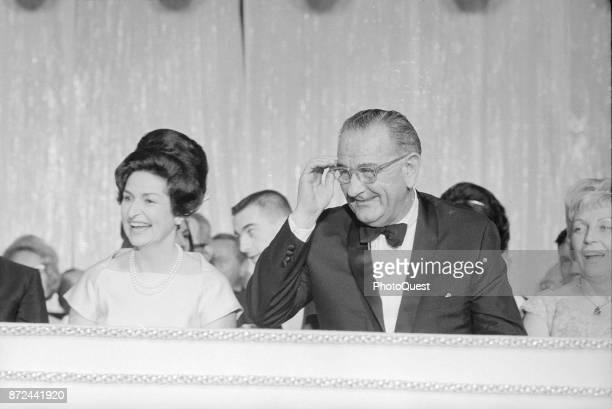 View of First Lady Lady Bird Johnson and US President Lyndon B Johnson laugh during an Inaugural Ball at the Sheraton Park Hotel Washington DC...