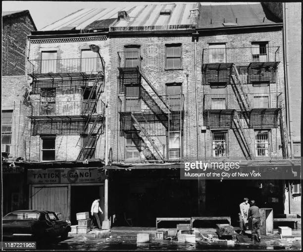 View of fish wholesalers on South Street, New York, New York, circa 1975.