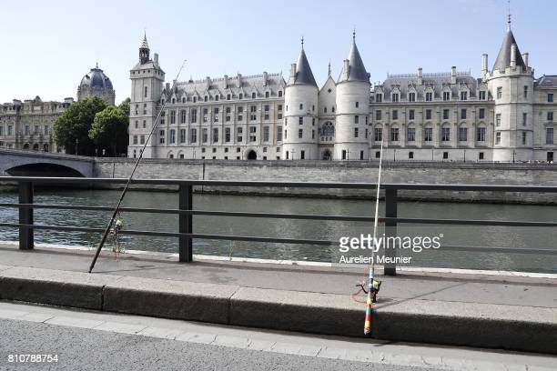 A view of fisher canes along the Seine in front of '36 Quai des Orfevres' Paris City Police headquarters during the opening day of Paris Plage on...