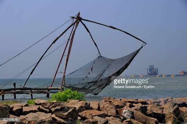 View Of Fishing Net On Beach Against Sky