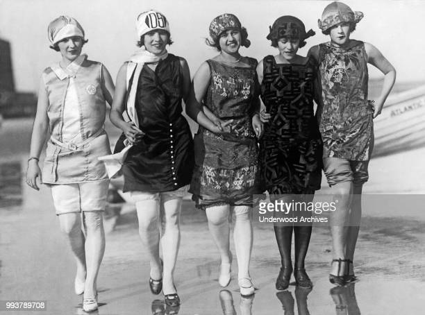 View of five of the contestants in the Miss America contest as they walk along the beach, Atlantic City, New Jersey, July 1924.