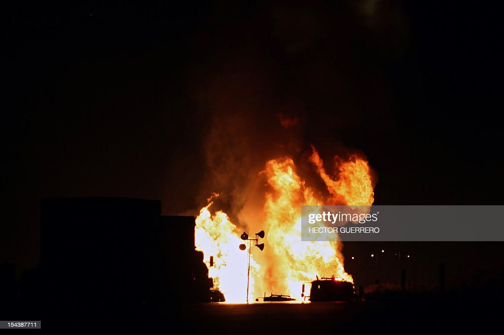 View of flames caused by the explosion of a gas pipeline in Zapotlanejo, 30 km from Guadalajara city, Jalisco State, Mexico on October 19, 2012. The explosion injured two people and forced the evacuation of 600 residents, according to local authorities. AFP PHOTO/Hector Guerrero