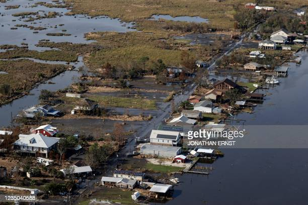 View of flood damaged buildings are seen as US President Joe Biden inspects the damage from Hurricane Ida onboard Marine One during an aerial tour of...