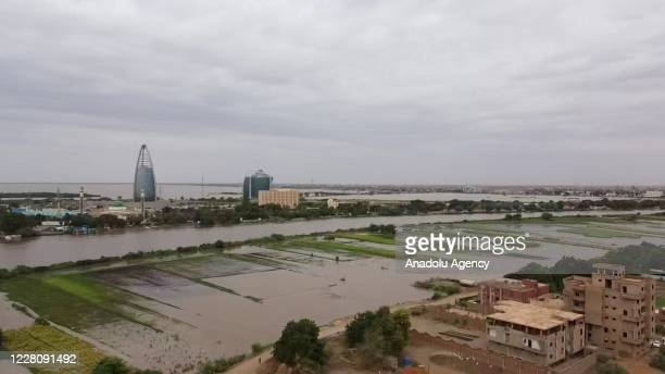 View of flooded some farmland on the riverbank and swelling Blue Nile as its water level rises after heavy rainfall in Khartoum, Sudan on August 17,...