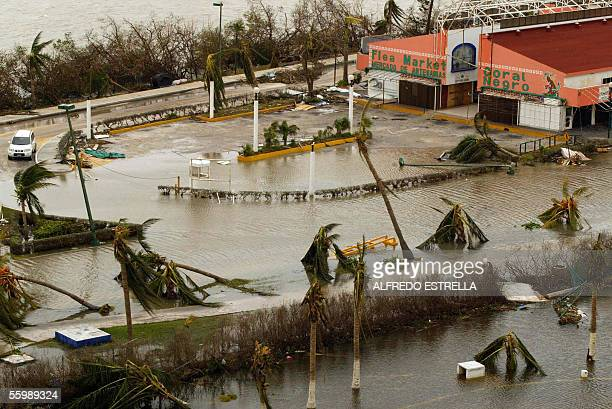 View of flooded streets 23 October in the hotel area in Cancun after the city was hit by Hurricane Wilma Although heavy rains had subsided as the...