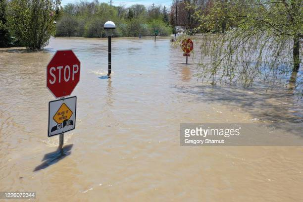 View of floodwaters flowing from the Tittabawassee River into the lower part of downtown Midland on May 20, 2020 in Midland, Michigan. Thousands of...
