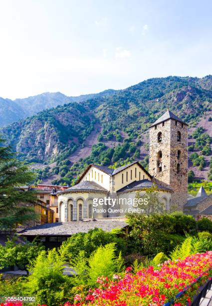 view of flowering plants and buildings against sky - andorra stock pictures, royalty-free photos & images