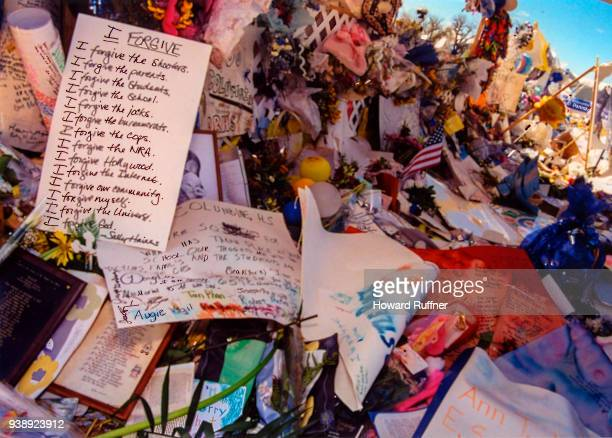 View of flowers and tokens left at a makeshift memorial in remembrance of 13 victims at Columbine High School Littleton Colorado April 21 1999 Two...