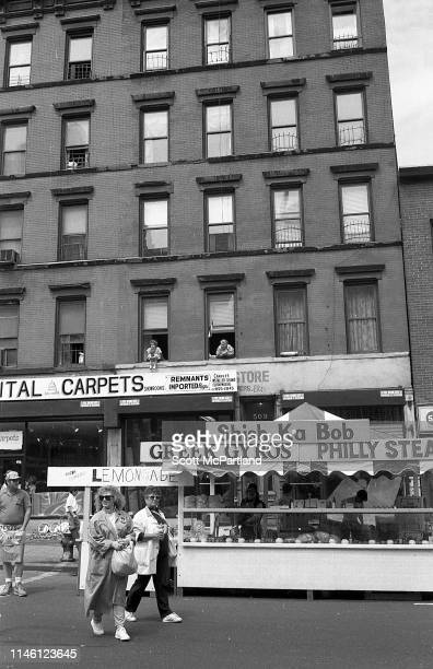 View of food and drink vendor's stalls on 9th Avenue in Hell's Kitchen during the International Food Festival New York New York May 14 1988 Visible...