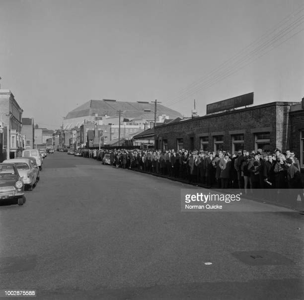 View of football fans and supporters of Chelsea FC queuing along a road outside Stamford Bridge Stadium as they wait to buy tickets for Chelsea's...