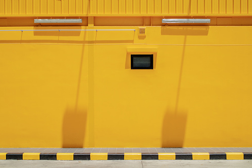 View Of Footpath With Yellow Building - gettyimageskorea