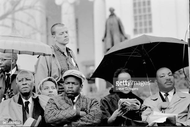 View of fore from left American Civil Rights and union leader A Philip Randolph Student Nonviolent Coordinating Committee President John Lewis and...