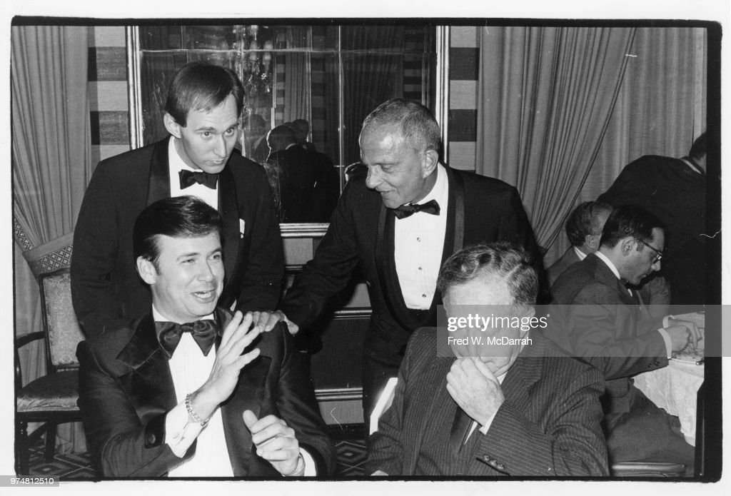 View of, fore, from left, Brooklyn Republican Party chairman George Leo Clark Jr and real estate developer Abraham Hirschfeld (1919 - 2005), and, rear, from left, political consultant Roger Stone and attorney Roy Cohn (1927 - 1986), as the talk during a Republican Party fundraising dinner at Waldorf Astoria Hotel, New York, New York, May 7, 1981 .