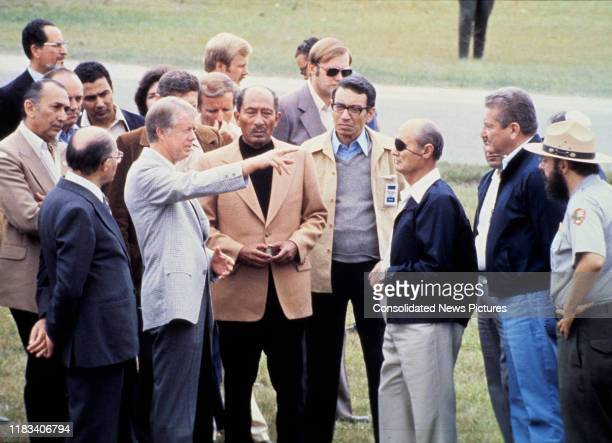 View of, fore from left, Israeli Prime Minister Menachem Begin , US President Jimmy Carter , Egyptian President Anwar Al Sadat , Egyptian Minister of...