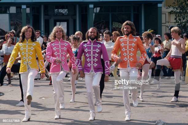 View of fore from left musicians Robin Gibb Peter Frampton and Maurice Barry Gibb in a scene from the film 'Sgt Pepper's Lonely Hearts Club Band' Los...