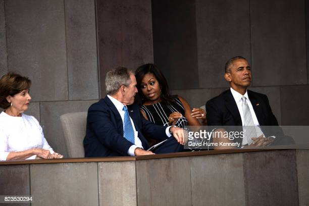 View of former First Lady Laura Bush former President George W Bush First Lady Michelle Obama and President Barack Obama as they attend the opening...