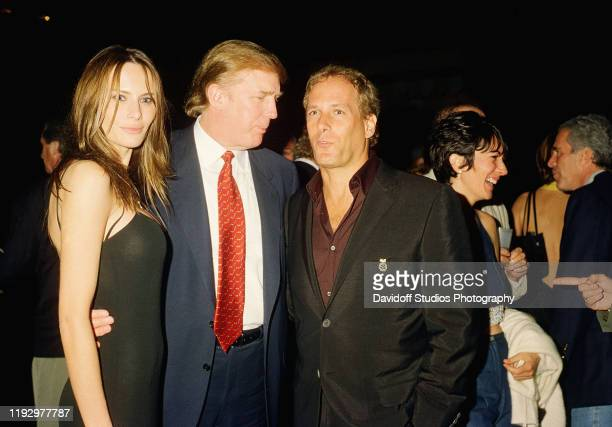 View of former model Melania Knauss and her boyfriend real estate developer Donald Trump as they pose with musician Michael Bolton at the MaraLago...