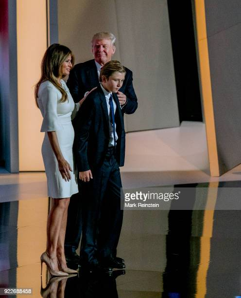 View of former model Melania Trump and her husband real estate developer and presidential candidate Donald Trump along with their son Barron on stage...