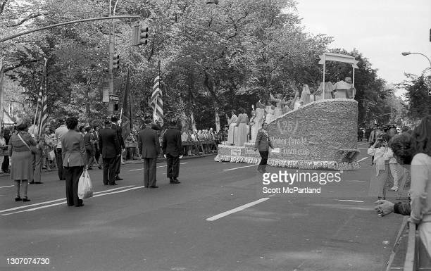 View of former parade queens riding together on a parade float as they wave to a crowd of spectators on 5th Avenue , during the 25th annual...
