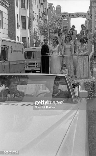 View of former parade queens riding together on a parade float being pulled along 5th Avenue during the 25th annual German-American Steuben parade,...