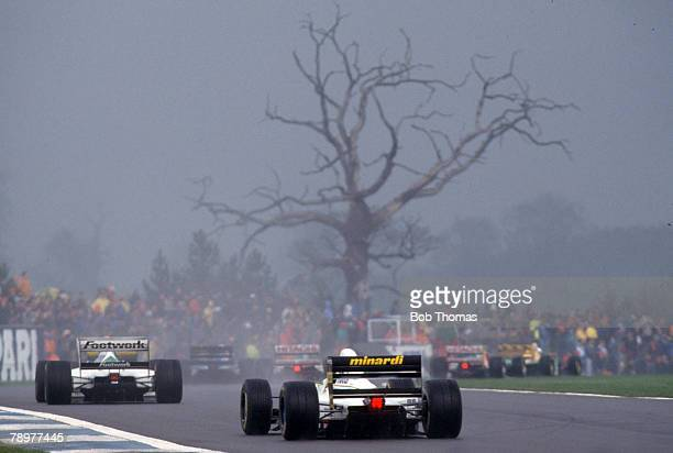 View of Formula One racing cars competing in gloomy conditions under stormy skies in the 1993 European Grand Prix at Donington Park in Leicestershire...