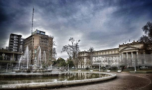 view of fountain and buildings - andres ruffo stock pictures, royalty-free photos & images