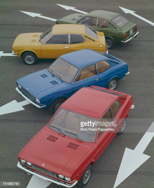 View of four Fiat 128 Coupe cars in red blue ochre and green recently unveiled at the Turin Motor Show in Italy in November 1971