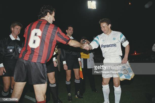 View of Franco Baresi, captain of AC Milan shaking hands and swapping pennants with Jean-Pierre Papin, captain of Olympique de Marseille prior to...